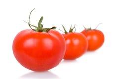 Tre pomodori isolati maturi Fotografia Stock Libera da Diritti