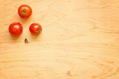 Tre pomodori rossi Immagine Stock Libera da Diritti