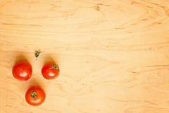 Tre pomodori rossi Fotografia Stock