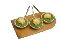 Tre porzioni di soufflè del broccolo Immagine Stock