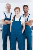 Tre pulitori professionali fotografia stock