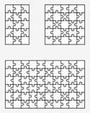 Tre puzzle bianchi Fotografia Stock