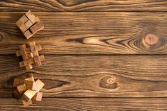 Tre puzzle o puzzle di legno complessi Immagine Stock