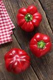 Tre röda peppar Fotografering för Bildbyråer