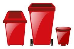 Tre röda trashcans i olika format Arkivfoto