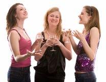 Tre ragazze che celebrano. Isolato su bianco Fotografia Stock Libera da Diritti