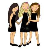Tre ragazze si sono vestite per una notte fuori Immagini Stock