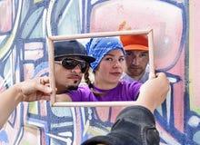 Tre rapper tramite uno specchio Fotografia Stock