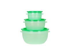 Tre recipienti di plastica verdi Immagine Stock