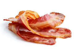 Tre remsor av stekt frasig bacon Fotografering för Bildbyråer