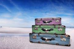 Tre resväskor på stranden Royaltyfri Fotografi
