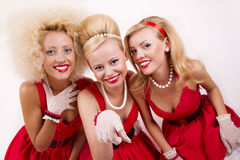 Tre retro flickor Arkivfoto