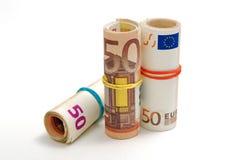 Tre rullar av 50 euroräkningar Arkivfoto