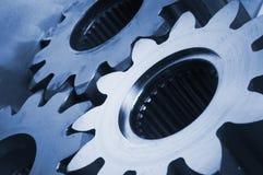 Tre ruote dentate in azzurro Fotografia Stock