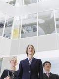 Tre säkra affärspersoner Arkivfoto