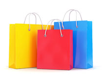 Tre sacchetti della spesa su fondo bianco Fotografie Stock Libere da Diritti