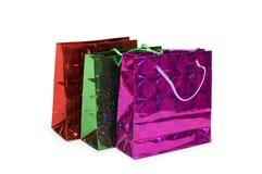 Tre sacchetti di acquisto isolati sul bianco Fotografie Stock Libere da Diritti