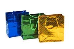 Tre sacchetti di acquisto isolati sul bianco Immagine Stock