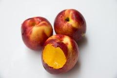 Tre saftiga persikor Royaltyfria Foton