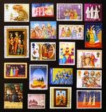 Tre saggi rappresentati su parecchi francobolli Fotografia Stock