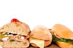 Tre sandwichs Arkivfoton
