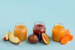 Tre sapori di alimenti per bambini fotografia stock libera da diritti
