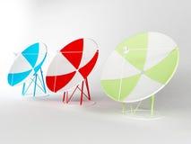 Tre satellit- antenner Fotografering för Bildbyråer