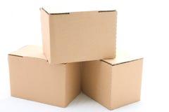 Tre scatole di cartone Fotografie Stock Libere da Diritti