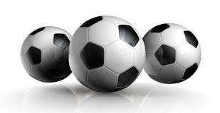Tre sfere di calcio Immagini Stock