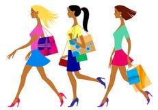 Tre shoppa flickor i plan stil Arkivbilder