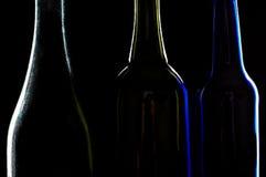 Tre siluette delle bottiglie Fotografia Stock