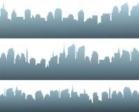 Tre siluette leggere della città Fotografia Stock Libera da Diritti