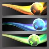 Tre skinande belysningjordklottitelrad/baner