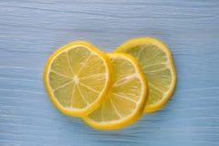 Tre skivor av citron Royaltyfria Bilder