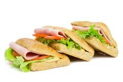 Tre smörgåsar med skivan av skinka Royaltyfria Bilder