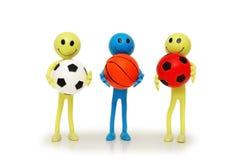 Tre smilies con i giochi del calcio Fotografia Stock Libera da Diritti