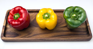 Tre spanska peppar, rött, gult och grönt Arkivbild