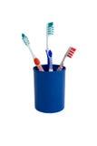 Tre spazzolini da denti Immagini Stock