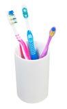 Tre spazzolini da denti in vetro ceramico Immagini Stock