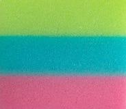 Tre spugne di colore stanno impilando Immagini Stock Libere da Diritti