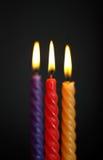 Tre stearinljus på Black Fotografering för Bildbyråer