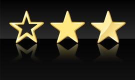 Tre stelle dorate su un fondo nero Fotografie Stock