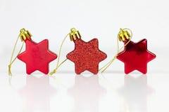 Tre stelle rosse di natale Immagini Stock Libere da Diritti