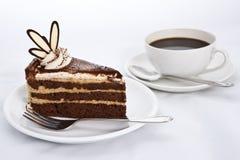 Tre strati della torta di cioccolato con caffè Immagine Stock Libera da Diritti