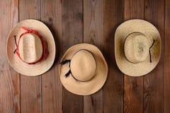 Tre Straw Hats Arkivfoto