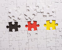 Tre stycken av pusslet. Begreppsbild av teamworkbyggnad Arkivbild