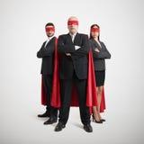 Tre superheroes i formella kläder Fotografering för Bildbyråer