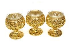 Tre supporti di candela dorati di plastica della tazza della tavola colorata Fotografia Stock Libera da Diritti