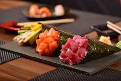 Tre sushi di temaki Fotografie Stock