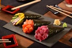 Tre sushi di temaki Fotografia Stock Libera da Diritti